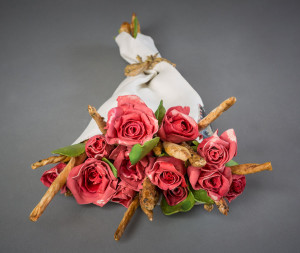 "Give Us Bread But Give Us Roses. Glazed Limoges porcelain. 5 1/4"" x 16"" x 10 1/2 "". 2013."