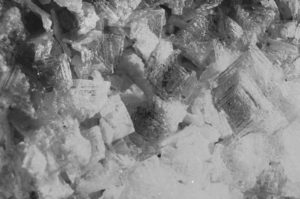 close up image of salt crystals all jammed together, looking like tiny square textured mountains of ice.