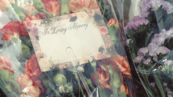funeral flowers by Elvert Barnes on flickr_with writing edited out