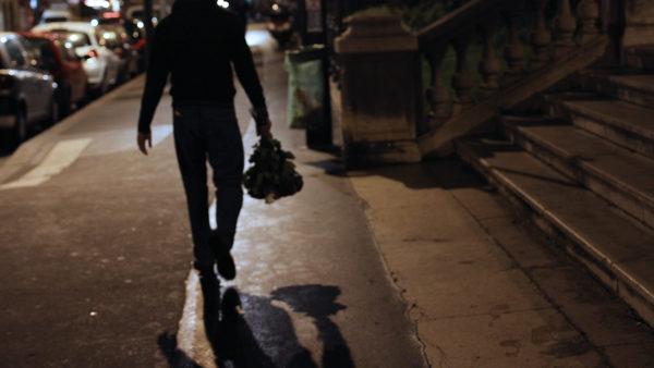 man walking street night